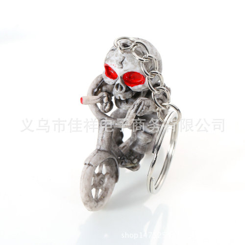 Skeleton With Red Eyes Riding Bicycle Smoking Cigarette Moulded Plastic Keyring